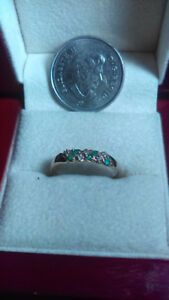 Elegant 10K gold ring with emeralds and diamonds