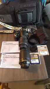 Nikon D3100 with extras!!!