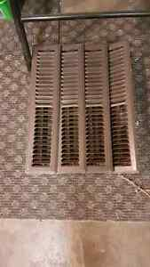 Long brown forced air heating vents