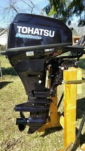 15 HP Tohatsu (Mercury) 4 stroke mint condition under warranty
