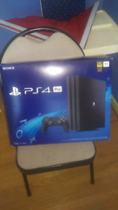 Brand new inbox Black PS4 PRO console, remote and game
