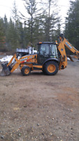 Backhoe and trucking