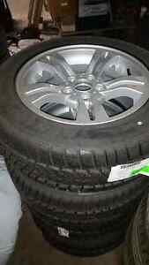 BMW X3 FACTORY RIMS WITH WINTER TIRES