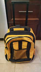 Carry on sized rolling backpack expandable with small pack