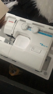 JANOME MYSTLE 100 SEWING MACHINE... BRAND NEW NEVER BEEN USED!!