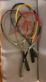 4 tennis rackets and a stunt kite