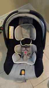 Chicco infant car seat with a base