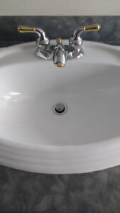 Beautiful bathroom sink and faucet. No scratches, chips or crack