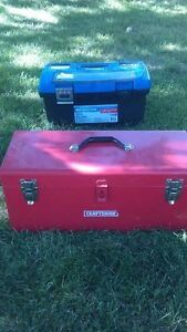 Two tool boxes with random tools