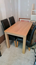 Dinning table and chairs x 4