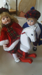 2 porcelain dolls and wooden horse
