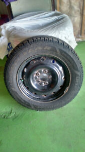 4 Goodyear Ultra Grip winter tires with rims