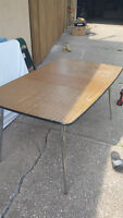 Dining room table with an extension for use as a work table