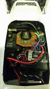 ACOMS racing car works good comes with remote and two batteries West Island Greater Montréal image 3