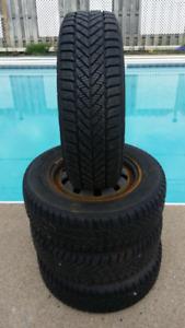 4 Goodyear Ultra Grip Ice on Rims (4 holes) P195/70R14