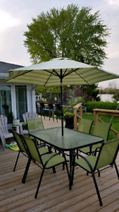 Beautiful 8 Piece Set! 6 Chairs, Table, and Umbrella :)