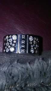 Brand new ring with several little diamonds