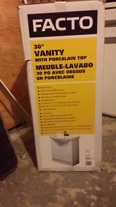 Meuble lavabo à vendre. Encore dans la boîte.