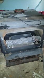 Electric woodstove for sale! Asking  200$ great for garages