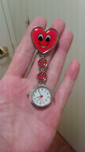 NURSE,  CAREGIVERS SMILEY FACE CLIP ON POCKET WATCH.