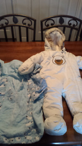New born snow suit and swaddler
