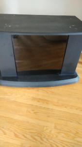 Black TV stand (shelving, on wheels)