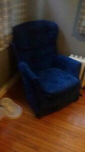 Blue velour Rocking/Swivel Chair.