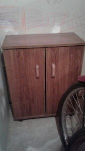 SMALL WOODEN CABINET WITH SHELVES ON ROLLERS