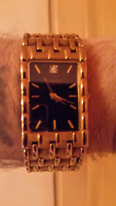 Bulova gold plated with real diamond at the 12 o'clock
