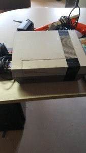 NES NINTENDO BUNDLE REFURBISHED WITH 4 GAMES AND ACCESSORIES