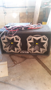 2 12' kicker subs with amp for sale