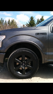 Brand new blacked out Lariet Rims and Tires