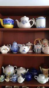 Big Collection of collectible porcelain teapots.