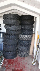 Pile of good used atv tires .