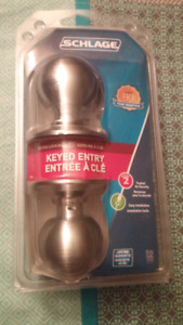 Schlage Orbit knob brass keyed entry door lock. Brand new packed