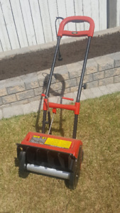 Red electric snow pusher