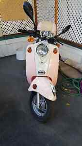 saga gas scooter