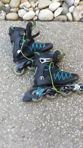 Size 7 Roller Blades, like new
