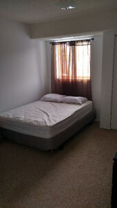 Two rooms for rent in a three bedroom townhouse