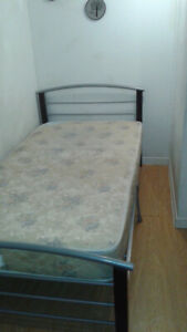 A clean room with A/C and free laundry near Mohawk