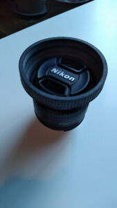 used Nikon 50mm f/1.8 prime lens with rubber hood and UV filter