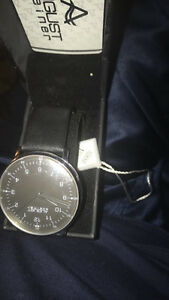 two august steiner watches (one with warranty)