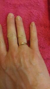 Womans 14 k gold diamond ring. Size 6