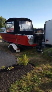 Boat with motor/cover/trailer/fish finder etc..