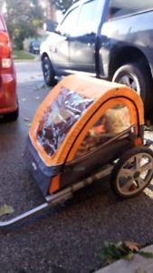Child carrier bike trailer.