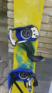 2 Snow boards with bindings, boots and burton bag
