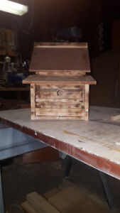 large hand crafted bird house