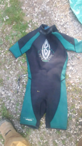 2 wetsuits for sale