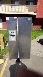 22.5 cu ft. With working ice and water dispenser.