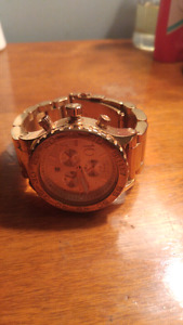 Nixon the 42-20 rose gold watch, like new $550 retail